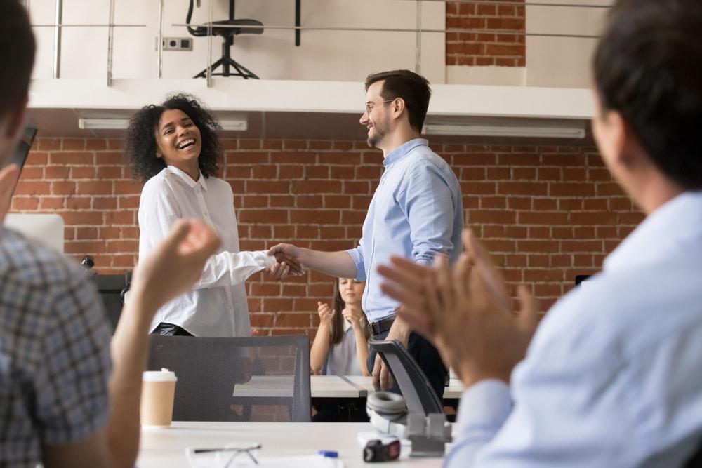 Grateful boss thanking employee - employee engagement millennials