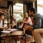 Engaged millennials working together - Employee Engagement Millennials