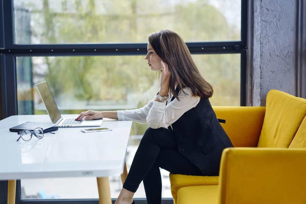 millennial using her laptop - employee engagement millennials